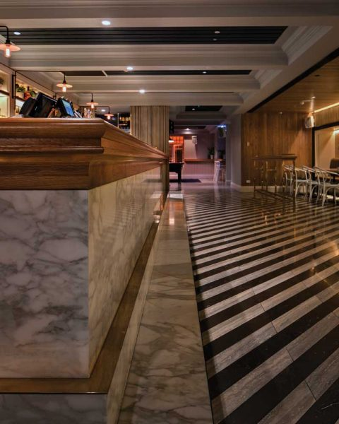 Detail photo of bar and floor at The Ivanhoe Hotel by Paul Kelly Design