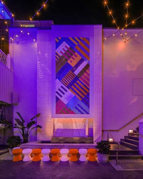 Tiled feature wall in outdoor area of The Ivanhoe Hotel, by Paul Kelly design