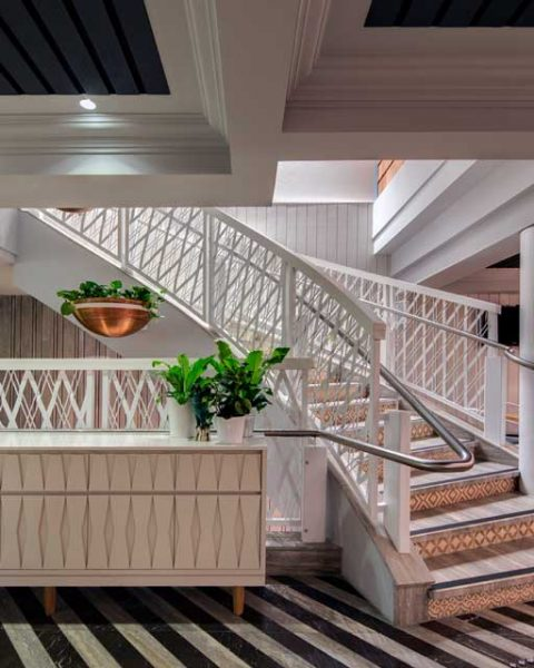 Staircase with light Hamptons feel at The Ivanhoe Hotel interior design by Paul Kelly Design