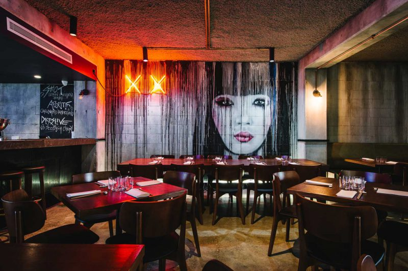 Mural and table arrangements at Salaryman, design by Paul Kelly Design