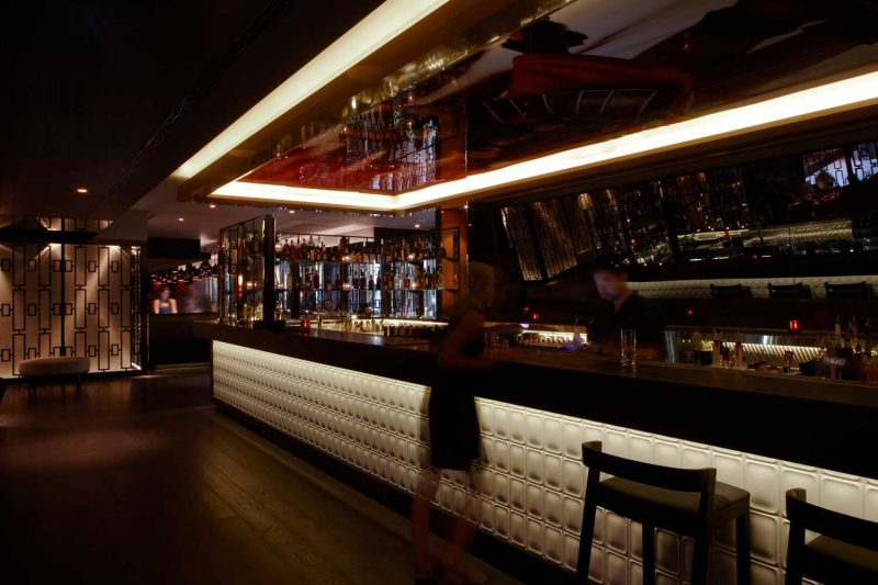 View of the bar at Sokyo with reflective mural on ceiling, design by Paul Kelly Design
