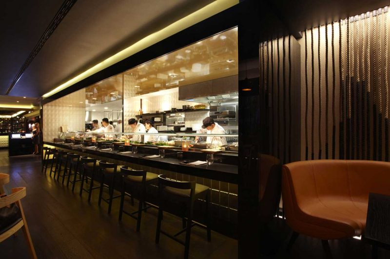 Chefs hard at work at Sokyo, design by Paul Kelly Design