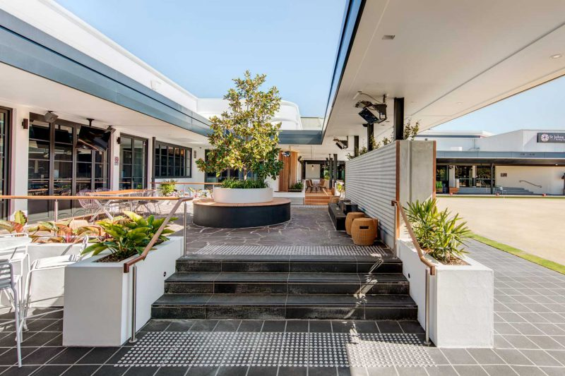 Exterior wide view of St Johns Park showing tiled surfaces and plantings by Paul Kelly Design