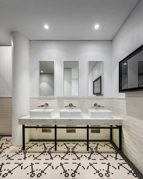 Bathroom featuring beautiful tile work at St Johns Park by Paul Kelly Design