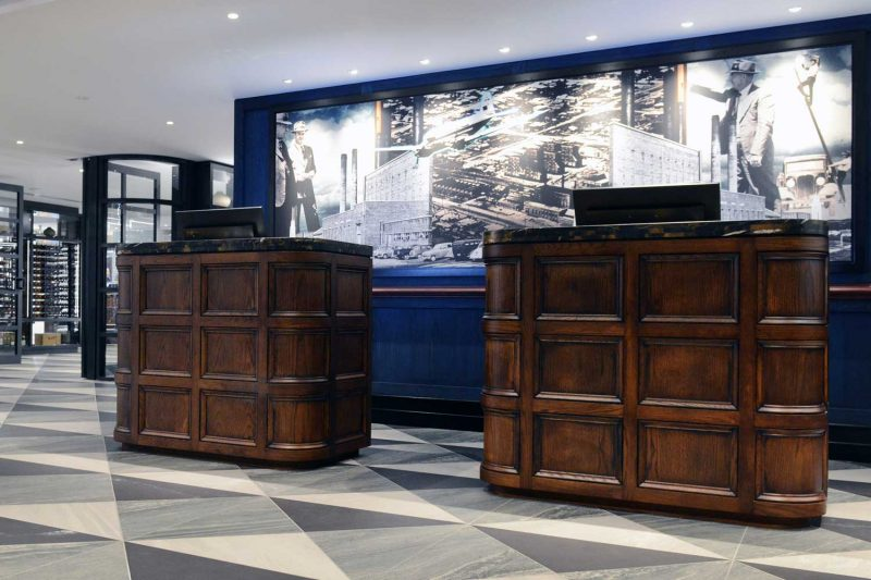 Alternative view of reception area showing custom mural artwork, design by Paul Kelly Design