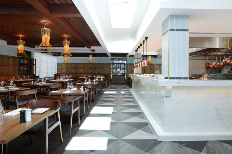 Marble bar, tiled floor and seating arrangement at The Workshop, design by Paul Kelly Design
