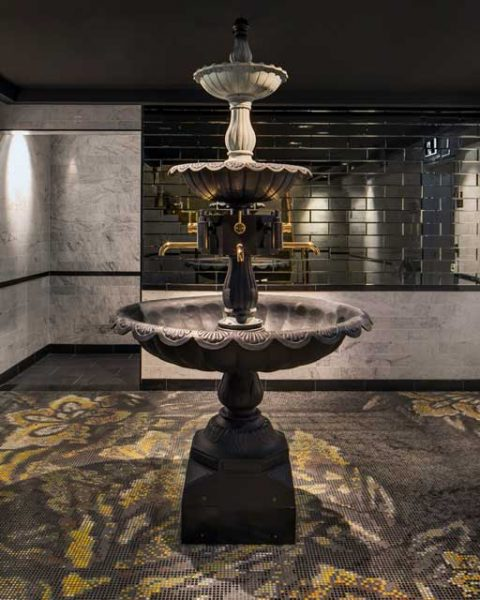 A feature fountain in the restrooms at The bourbon, design by Paul Kelly Design