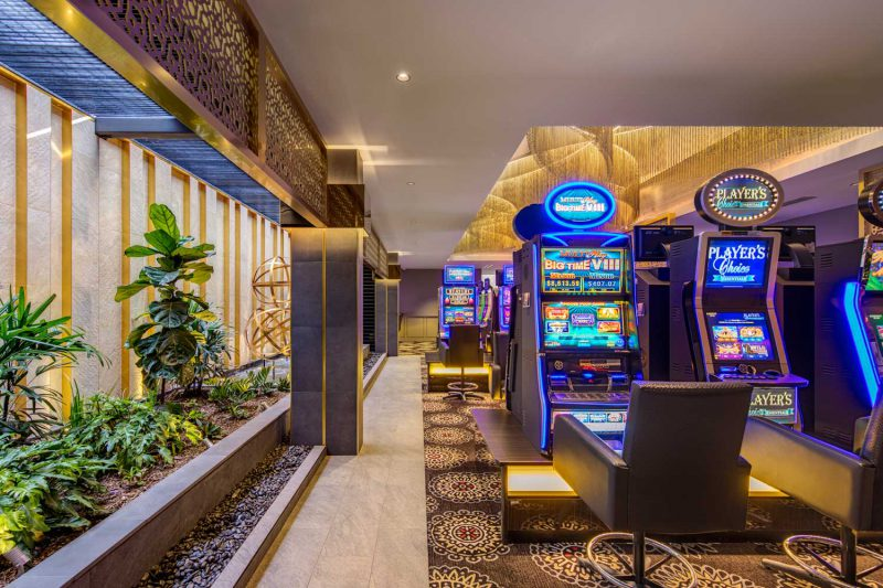 Indoor garden and gaming machines at the Gregory Hills Hotel, design by Paul Kelly Design