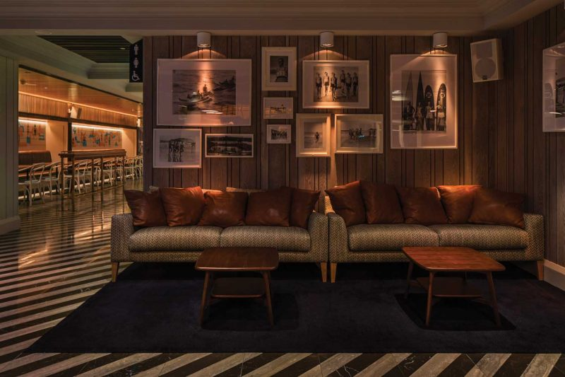 Photograph of sofa with picture arrangement at The Ivanhoe Hotel designed by Paul Kelly Design