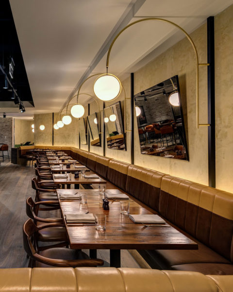 Paul Kelly Design District Dining Chifley banquette seating leather wall lights curves